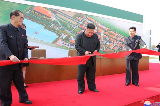 Kim Jong Un took part in a tape-cutting ceremony at the Sunchon Phosphatic Fertilizer Factory on May 1, according to state media. Recent reports indicate the factory may have remained incomplete at the time. File Photo by KCNA/UPI
