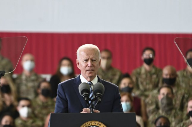 President Joe Biden speaks from the podium at Royal Air Force in Mildenhall, Britain on Tuesday. A new poll released Thursday by Pew Research said that the image of the United States around the world has improved since he was elected. Photo by Senior Airman Joseph Barron/U.S. Air Force/UPI