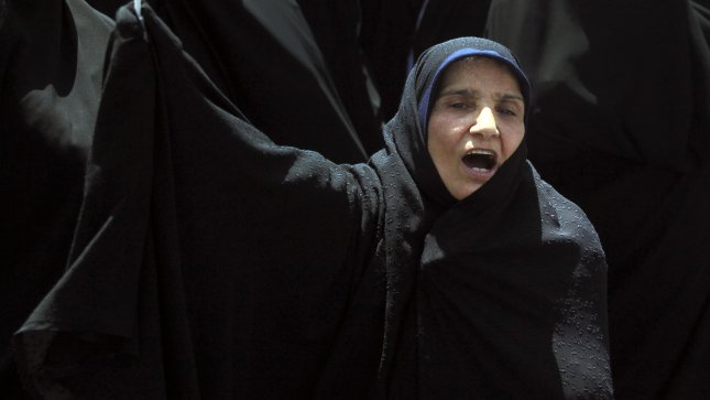 An Iranian protester shouts anti-US slogans during a protest rally against Saudi interference in Bahrain, in Tehran, Iran on May 18, 2012. UPI/Maryam Rahmanian