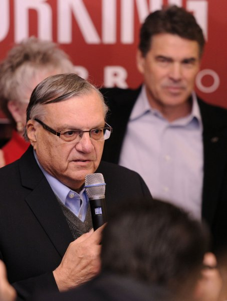 Maricopa County (Ariz.) Sheriff Joe Arpaio (L) at a rally for Republican presidential hopeful, Texas Gov. Rick Perry (R) in Council Bluffs, Iowa, Dec. 27, 2011. UPI/Mike Theiler