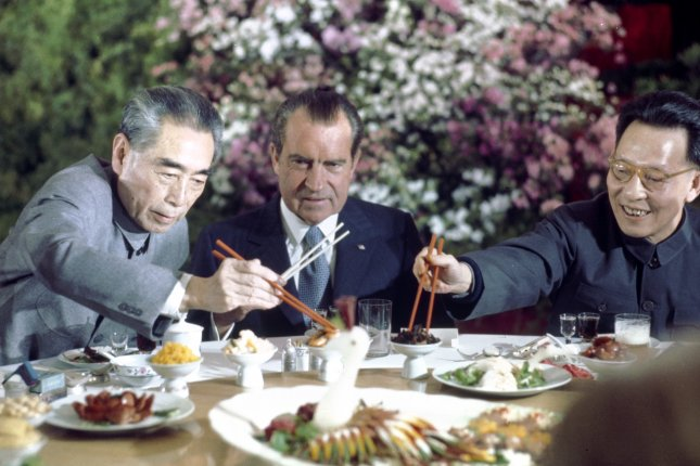 President Richard Nixon (C) at the farewell banquet upon completion of his historic visit to China on February 27, 1972. At left is premier Chou En-Lai and at right is Communist Party Leader Chang Chung-chiao. File photo UPI.