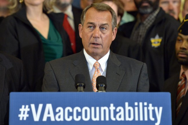 Speaker of the House John Boehner, R-Ohio, is joined by veterans as he speaks during a press conference on legislation that would bring greater accountability to the Department of Veterans' Affairs, on Capitol Hill. UPI/Kevin Dietsch