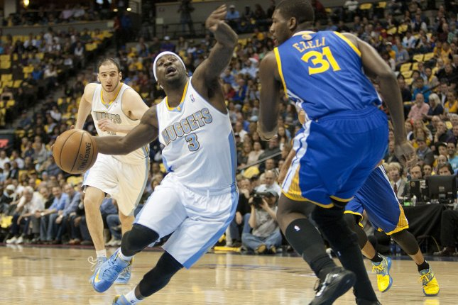 Former Denver Nuggets guard Ty Lawson (3) drives against Golden State Warriors' Festus Ezeli in the first quarter during the NBA's first round playoffs game five at the Pepsi Center in Denver. UPI file photo/Gary C. Caskey