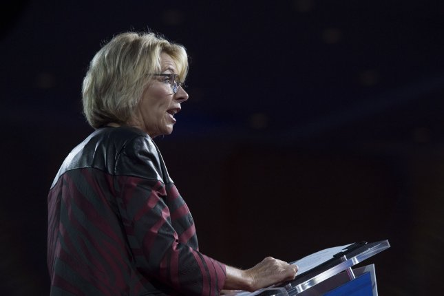 U.S. Secretary of Education Betsy DeVos speaks during the Conservative Political Action Conference in National Harbor, Maryland, on February 23. On Thursday, the Education Department revoked federal guidance that barred debt collectors from charging interest rates of up to 16 percent on past-due student loans. Photo by Molly Riley/UPI