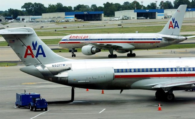 American Airlines Mother Struck By Stroller Tried Fitting Large Buggy On Plane