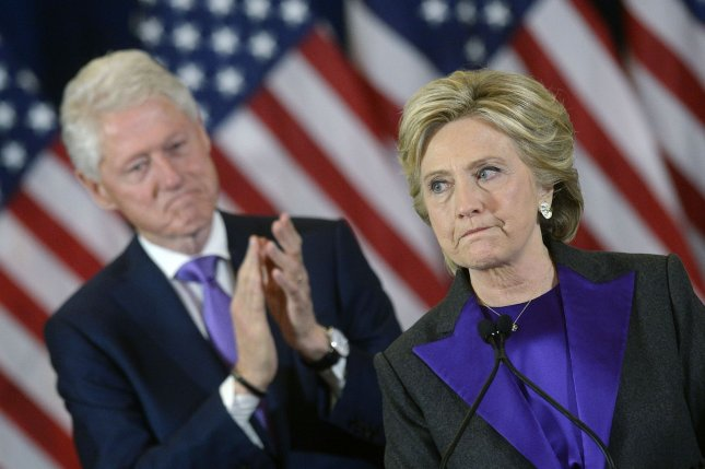 Democratic presidential nominee Hillary Clinton delivers her concession speech on November 9 after her election defeat to Donald Trump, as husband and former President Bill Clinton looks on. File Photo by Olivier Douliery/UPI