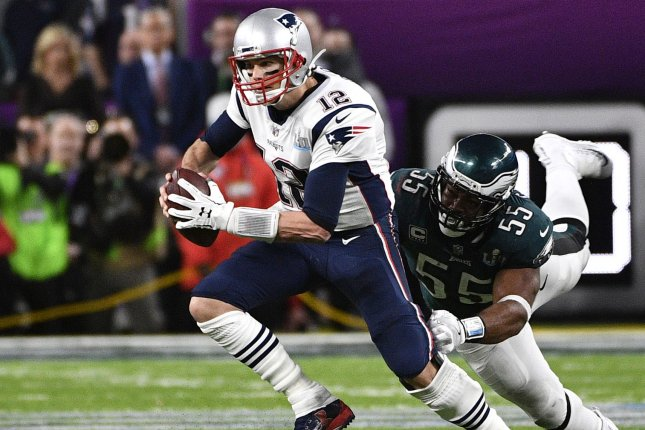 Philadelphia Eagles defensive end Brandon Graham (55) stops New England Patriots quarterback Tom Brady (12) during the fourth quarter of Super Bowl LII on February 4 at U.S. Bank Stadium in Minneapolis. Photo by Brian Kersey/UPI