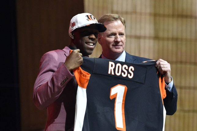 The Cincinnati Bengals selected John Ross (L) with the No. 9 overall pick in the 2017 NFL Draft. The team denied trade rumors surrounding the wide receiver Wednesday at the NFL scouting combine in Indianapolis. File Photo by Derik Hamilton/UPI