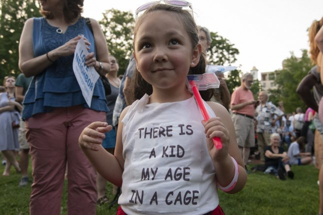 A young girl is seen July 12 among hundreds of protesters at a pro-immigration rally in Washington, D.C.'s Lafayette Square, across the street from the White House. Photo by Pat Benic/UPI