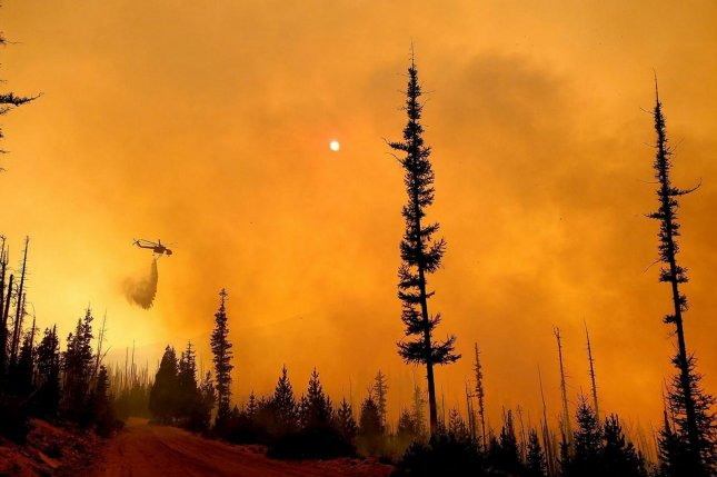 Efforts to combat the 87 large fires across the West was expected to be hampered Monday by strong, gusty winds in northern California and southeast Oregon, while dense smoke was expected to continue to impact much of the western United States. Photo courtesy of U.S. Forest Service Pacific Northwest Region/UPI