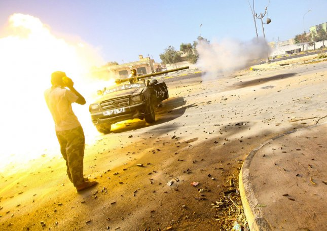 A member of Libya's ruling National Transitional Council (NTC) fires at pro-Gaddafi forces during clashes in eastern Libya, September 24, 2011. Fighters for Libya's interim rulers entered Moamer Kadhafi's hometown of Sirte today in a surprise assault that NATO said it backed to halt brutal acts by followers of the ousted regime. UPI/Amru Taha