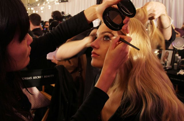 A model has her hair and make up done before the Victoria's Secret Fashion show in New York City on November 19, 2009. (UPI Photo/John Angelillo) .