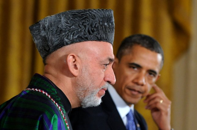 U.S. President Barack Obama, seen here with Afghanistan President Hamid Karzai in January 2013, is frustrated by Karzai's delay in signing the U.S.-Afghanistan security agreement. (UPI/Pat Benic)