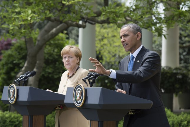 President Barack Obama and German Chancellor Angela Merkel hold a joint press conference in the Rose Garden at the White House in Washington, D.C. on May 2, 2014. Obama and Merkel spoke about their country's joint efforts in protecting economic and security interests for the U.S. and Europe. (UPI/Kevin Dietsch)