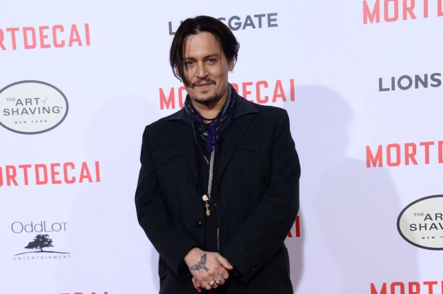 Cast member Johnny Depp attends the premiere of the motion picture comedy Mortdecai at the TCL Chinese Theatre in the Hollywood section of Los Angeles on January 21, 2015. Johnny Depp visits sick children in Brisbane hospital dressed as Captain Jack Sparrow. File Photo by Jim Ruymen/UPI