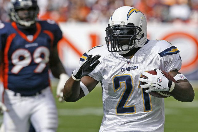 San Diego Chargers' LaDainian Tomlinson (R) gains nine yards against Denver Broncos Alvin McKinley during the first quarter at Invesco Field at Mile High in Denver on October 7, 2007. (UPI Photo/Gary C. Caskey)