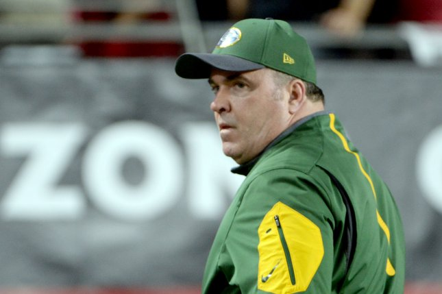 Green Bay Packers head coach Mike McCarthy leaves the field after the Packers-Arizona Cardinals game at University of Phoenix Stadium in Glendale, Arizona on January 16, 2016. The Cardinals defeated the Packers 26-20 in overtime. Photo by Art Foxall/UPI