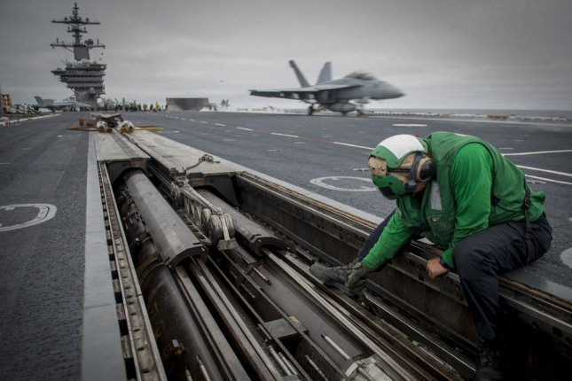 Ships with the San Diego-based Carl Vinson carrier strike group may take part in freedom of navigation operations in the South China Sea, according to sources in the U.S. Navy. Photo by Specialist 3rd Class Sean Castellano/U.S. Navy/UPI