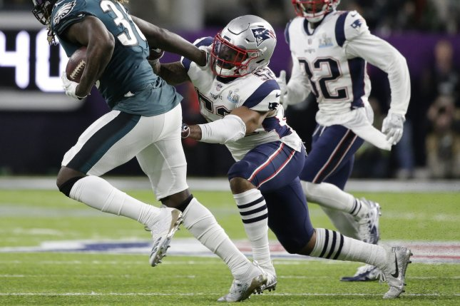 Philadelphia Eagles running back Jay Ajayi (36) runs with the ball as New England Patriots linebacker Elandon Roberts (52) tries to tackle him in the second quarter of Super Bowl LII on February 4, 2018 at U.S. Bank Stadium in Minneapolis, Minnesota. Photo by John Angelillo/UPI