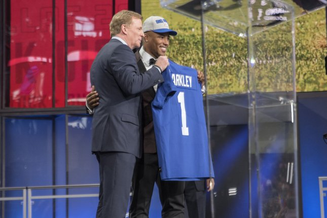 Saquon Barkley celebrates with NFL Commissioner Roger Goodell after being chosen as the second overall pick by the New York Giants in the 2018 NFL Draft at AT&T Stadium in Arlington, Texas on April 26, 2018. Photo by Sergio Flores/UPI