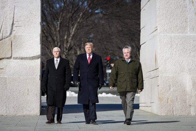 Acting Interior Secretary David Bernhardt (R), walks with President Donald Trump (C), Vice President Mike Pence (L) at the Martin Luther King Jr. Memorial on Jan. 21. Bernhardt announced protection changes Friday for the sage grouse bird. Photo by Pete Marovich/UPI