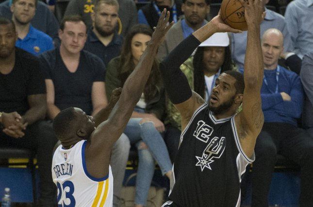 San Antonio Spurs forward LaMarcus Aldridge (R) underwent the procedure at the end of April. File Photo by Terry Schmitt/UPI