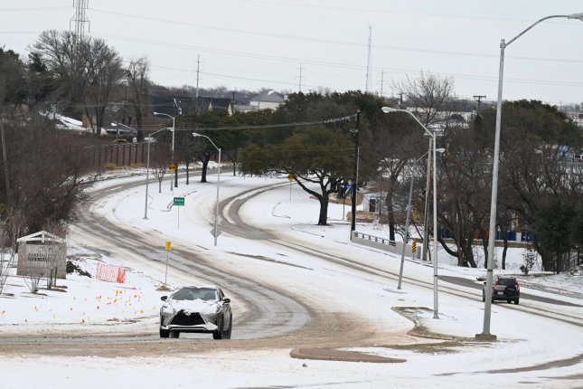 Drivers make their way along snow-packed roads near Dallas on February, 16. President Joe Biden is visiting Houston on Friday to review the effects of this month's historic winter storm. Photo by Ian Halperin/UPI