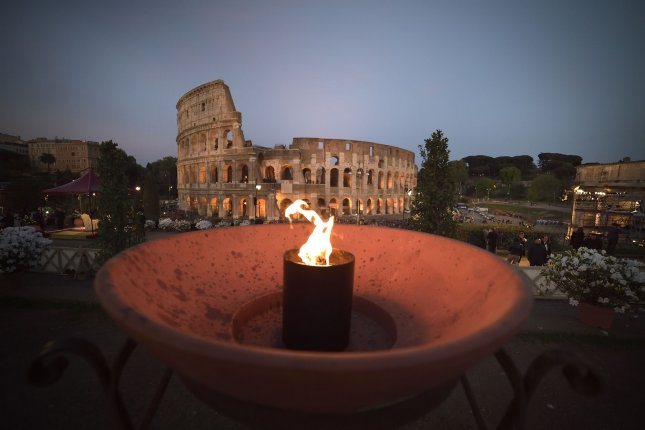Pope Francis prays during the Via Crucis (Way of the Cross) torchlight procession at the ancient Colosseum in 2019 in Rome. Italy announced that the Colosseum floor will be replaced. File Photo by Stefano Spaziani/UPI