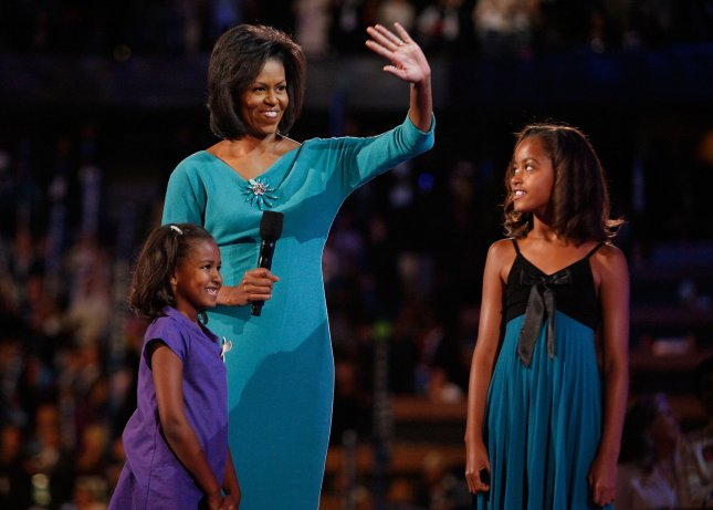 Michelle Obama and daughters Malia (R), and Sasha at the 2008 Democratic National Convention on August 25, 2008. (UPI Photo/Brian Kersey)