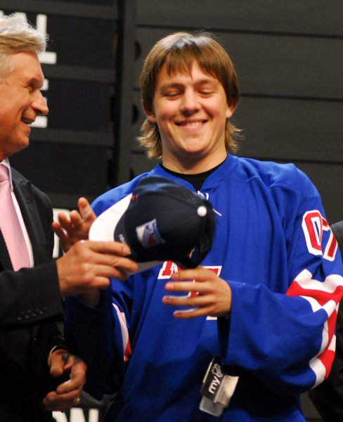 Alexei Cherepanov receives his hat and jersey from the N.Y Rangers during the first round of the 2007 NHL Entry Draft at Nationwide Arena in Columbus, Ohio on June 22, 2007. Cherepanov is the seventeenth overall pick and considered to be the top European draft pick. (UPI Photo/ Stephanie Krell)