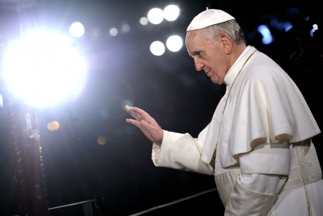 Pope Francis presides over the Via Crucis (Way of the Cross) torchlight procession on Good Friday in front of the Colosseum in Rome on March 29, 2013. UPI/Stefano Spaziani