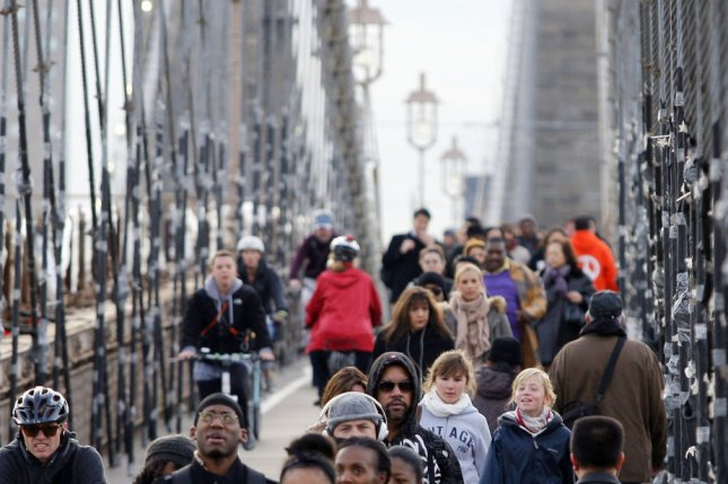 Commuters cross the Brooklyn Bridge Nov. 2, 2012, days after Hurricane Sandy left parts of New York City without mass transit. UPI/John Angelillo