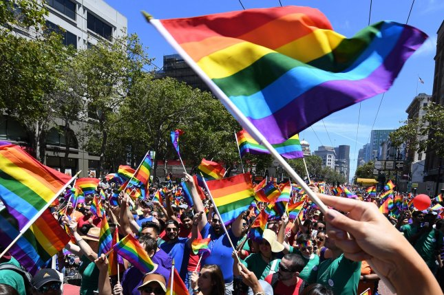 A contingent from Apple Computer waves rainbow flags in the annual LGBT Pride parade in San Francisco on June 26. The 7th Circuit Court of Appeals on Tuesday found that the Civil Rights Act protects LGBT people from being discriminated against in the workplace. File Photo by Terry Schmitt/UPI