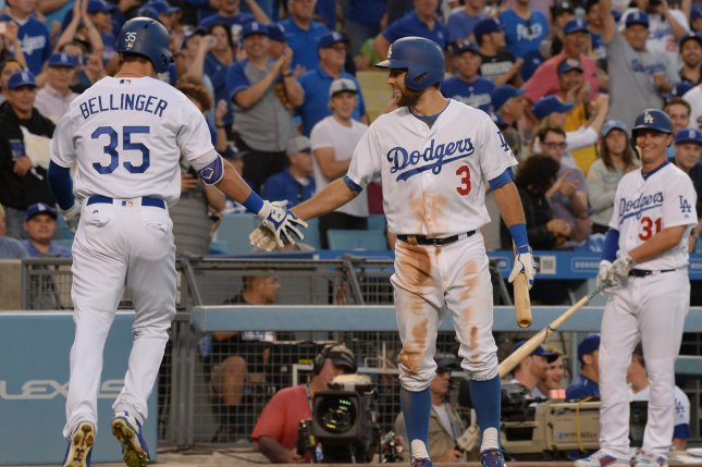 Los Angeles Dodgers' first baseman Cody Bellinger celebrates with teammate Chris Taylor after hitting a solo home run in the second inning against the New York Mets at Dodger Stadium in Los Angeles on June 19, 2017. Bellinger hit two home runs, driving in four runs and powering the Dodgers to a 106 victory. Photo by Jim Ruymen/UPI