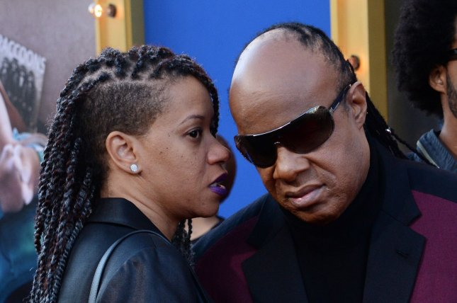 Stevie Wonder (R) and Tomeeka Robyn Bracy attend the Los Angeles premiere of Sing on December 3, 2016. The couple tied the knot at a lavish wedding in Los Angeles. File Photo by Jim Ruymen/UPI