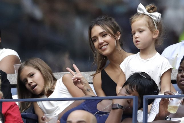 Jessica Alba (C), pictured with daughters Honor and Haven, welcomed son Hayes with Cash Warren in December. File Photo by John Angelillo/UPI