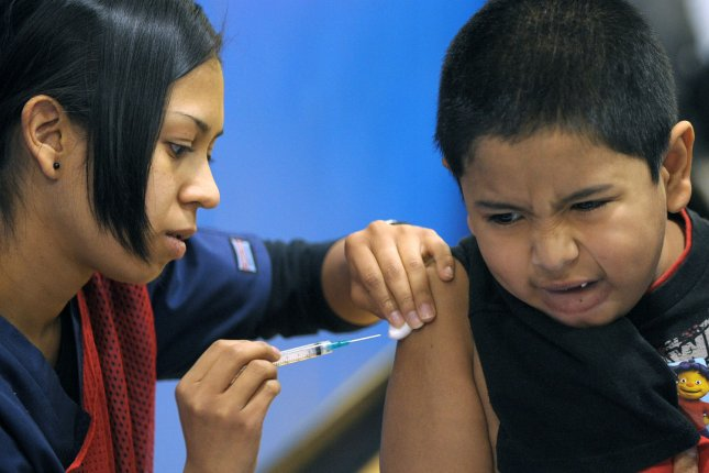Analysis of CDC vaccination data suggests too few children receive the flu shot each year, in spite of virus severity and vaccine effectiveness. File Photo by Roger L. Wollenberg/UPI