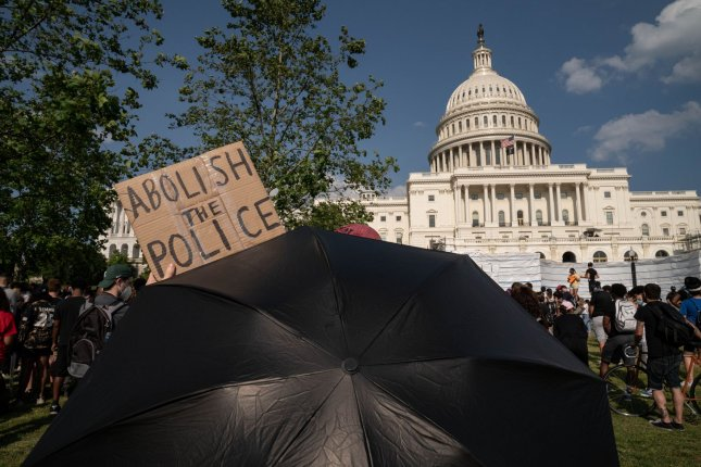 Activists rally during a demonstration Thursday against police brutality and the death of George Floyd, at the U.S. Capitol in Washington, D.C. Photo by Ken Cedeno/UPI