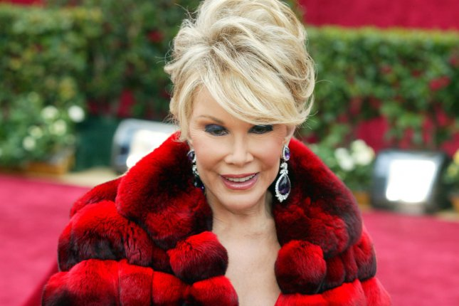 Joan Rivers arrives for the 79th Annual Academy Awards, held at the Kodak Theatre in Hollywood, California, on February 25, 2007. The comedian died September 4, 2014, at age 81. File Photo by Terry Schmitt/UPI