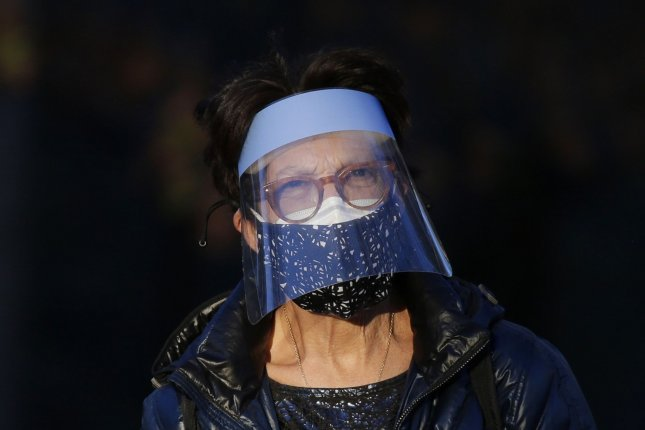 A woman wears a face mask and face shield to protect from and prevent the spread of COVID-19 in Central Park in New York City on November 20. File photo by John Angelillo/UPI
