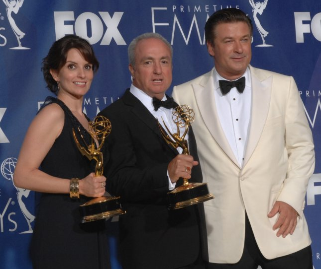 Tina Fey (L), Lorne Michaels and Alec Baldwin appear backstage with the Emmys they won for '30 Rock' at the 59th Primetime Emmy Awards at the Shrine Auditorium in Los Angeles on September 16, 2007. (UPI Photo/Scott Harms)