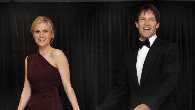 Actress Anna Paquin leads her husband Stephen Moyer and co-star in the TV series True Blood, as they walk the red carpet as they arrive for the annual White House Correspondent's Association dinner, April 30, 2011, in Washington,D.C. President Obama will attend the dinner, which combines the administration's top officials, Capitol Hill politicians and Hollywood glitz and glamour. UPI/Mike Theiler
