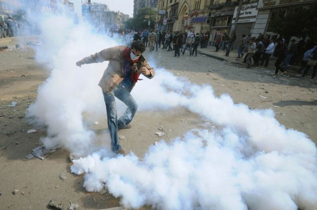 Protesters dodge tear gas as thousands of Egyptians participate in a fourth day of clashes in Tahrir Square in Cairo in Egypt on November 22, 2011. Demonstrators are demanding an end to military rule as tension heightens after days of deadly clashes that threaten to derail next week's legislative poll. UPI/Mohamed Hossam