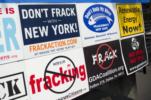 Anti fracking signs are seen during a protest in Syracuse, New York on August 22, 2013. UPI/Kevin Dietsch
