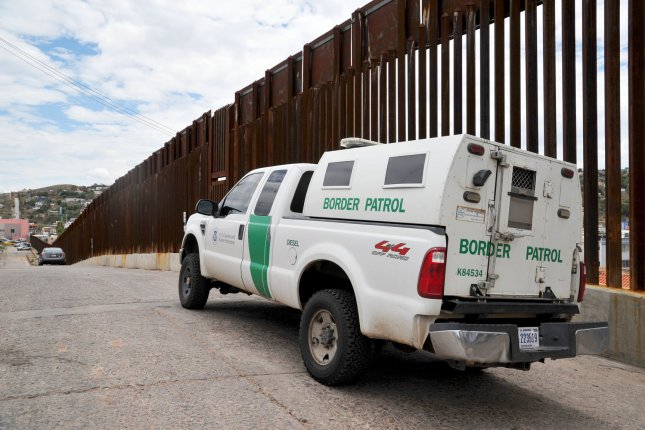 A United States Border Patrol truck sits next to the border fence between the United States and Mexico near Nogales, Arizona on July 13, 2014. More than 57,000 children from Central America have crossed the U.S. border alone since October 1, 2013. President Obama has asked congress for $3.7 million to deal with the influx. UPI/Art Foxall