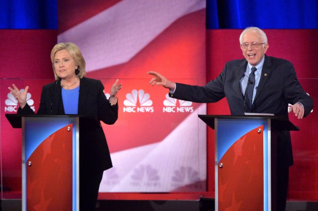 A group of 10 national security officials, past and present, rallied behind Hillary Clinton in condemning Sen. Bernie Sanders, D-Vt., for his remarks about normalizing relations with Iran during the Democratic presidential debate Sunday in Charleston, S.C. Photo by Kevin Dietsch/UPI