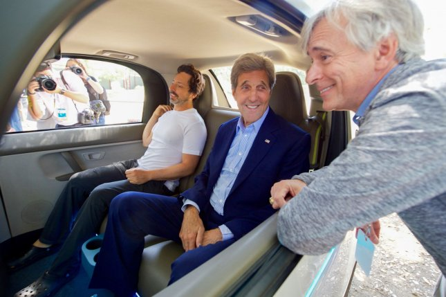 U.S. Secretary of State John Kerry (C) with Google Co-Founder Sergey Brin (L) inside one of Google's self-driving cars on June 23, 2016. Monday the U.S. Department of Transportation issued guidelines on the building and use of autonomous cars, emphasizing safety. Photo by U.S. Department of State/UPI