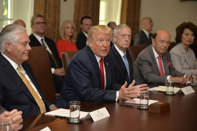 President Donald Trump (C) speaks Monday during a Cabinet meeting at the White House, including (L-R) Secretary of State Rex Tillerson, Defense Secretary James Mattis, Commerce Secretary Wilbur Ross and Transportation Secretary Elaine Chao. Photo by Mike Theiler/UPI