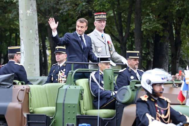 French President Emmanuel Macron (L) .called for a united European defense and security during a Bastille Day celebration on Sunday. Photo by David Silpa/UPI