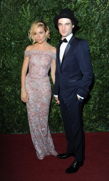 Actress Sienna Miller and actor Tom Sturridge attend the London Evening Standard Theatre Awards in London in 2014. Sturridge's Starz dramedy Sweetbitter has been canceled after two seasons. File Photo by Paul Treadway/UPI
